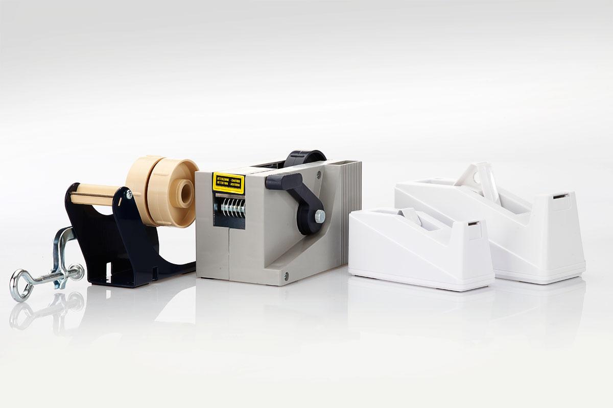 Abrollgeräte - Tischgeräte sind als Beutelschließer, Tischabroller mit Zwinge, Streifengeber und Adressenschutzfilmabroller verfügbar